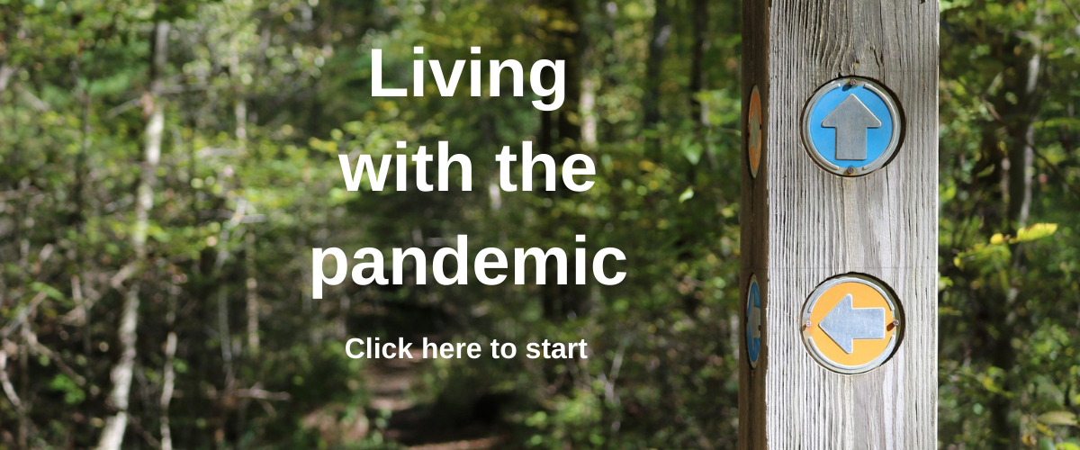 Image of trail with arrows marking navigation and text living with the pandemic. Click anywhere to start.